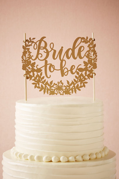 Alexis Mattox Gold Bride to Be Cake Topper | BHLDN