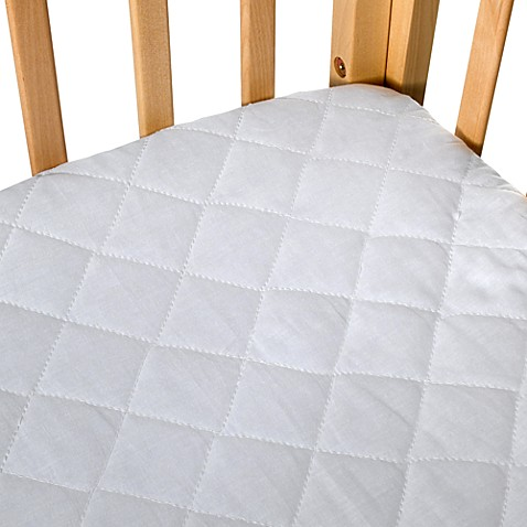 bb basics quilted waterproof portable crib pad cover bed bath beyond. Black Bedroom Furniture Sets. Home Design Ideas