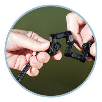 A man's hands holding the Snap 'N' Stay System