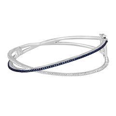 1/10 CT. T.W. White and Color-Enhanced Blue Diamond Crisscross Bangle Bracelet