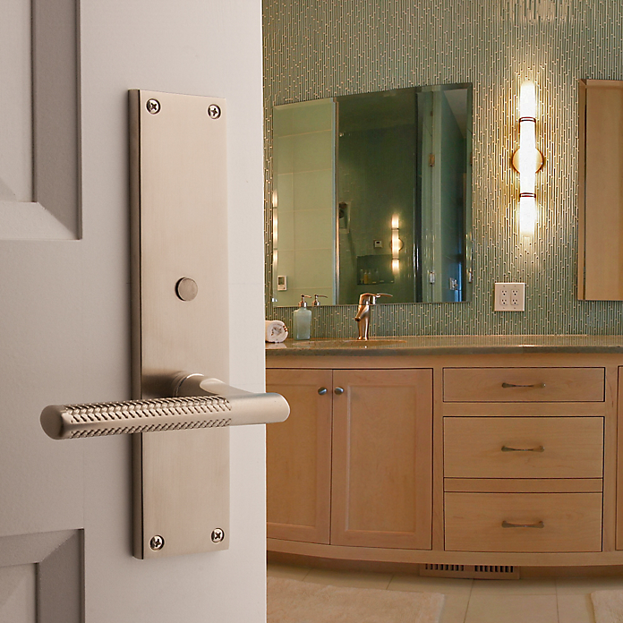The L015 Couture lever is paired with the Atlanta interior escutcheon for a stately look on the master bathroom door.