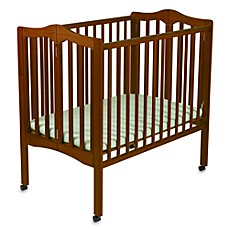 image of Delta Children's Portable Crib in Cherry
