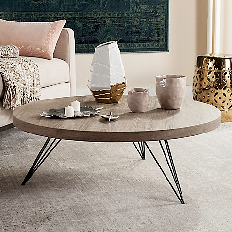 safavieh mansel round coffee table in light grey bed bath beyond. Black Bedroom Furniture Sets. Home Design Ideas