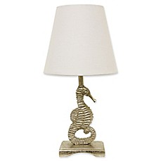 image of Décor Therapy Sea Horse Accent Lamp in Silver Leaf with White Linen Shade