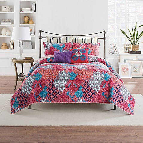 anthology™ minka reversible quilt in fuchsia - bed bath & beyond