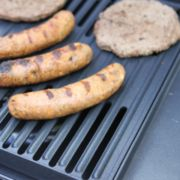 close up of griddle on portable propane grill image number 4