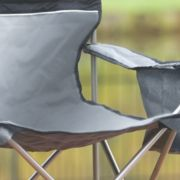 Folding chair with storage arm image number 2