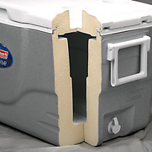 The corner of a Coleman Cooler with the sides cut away to display the insulation that runs from the bottom, up the sides and into the lid.
