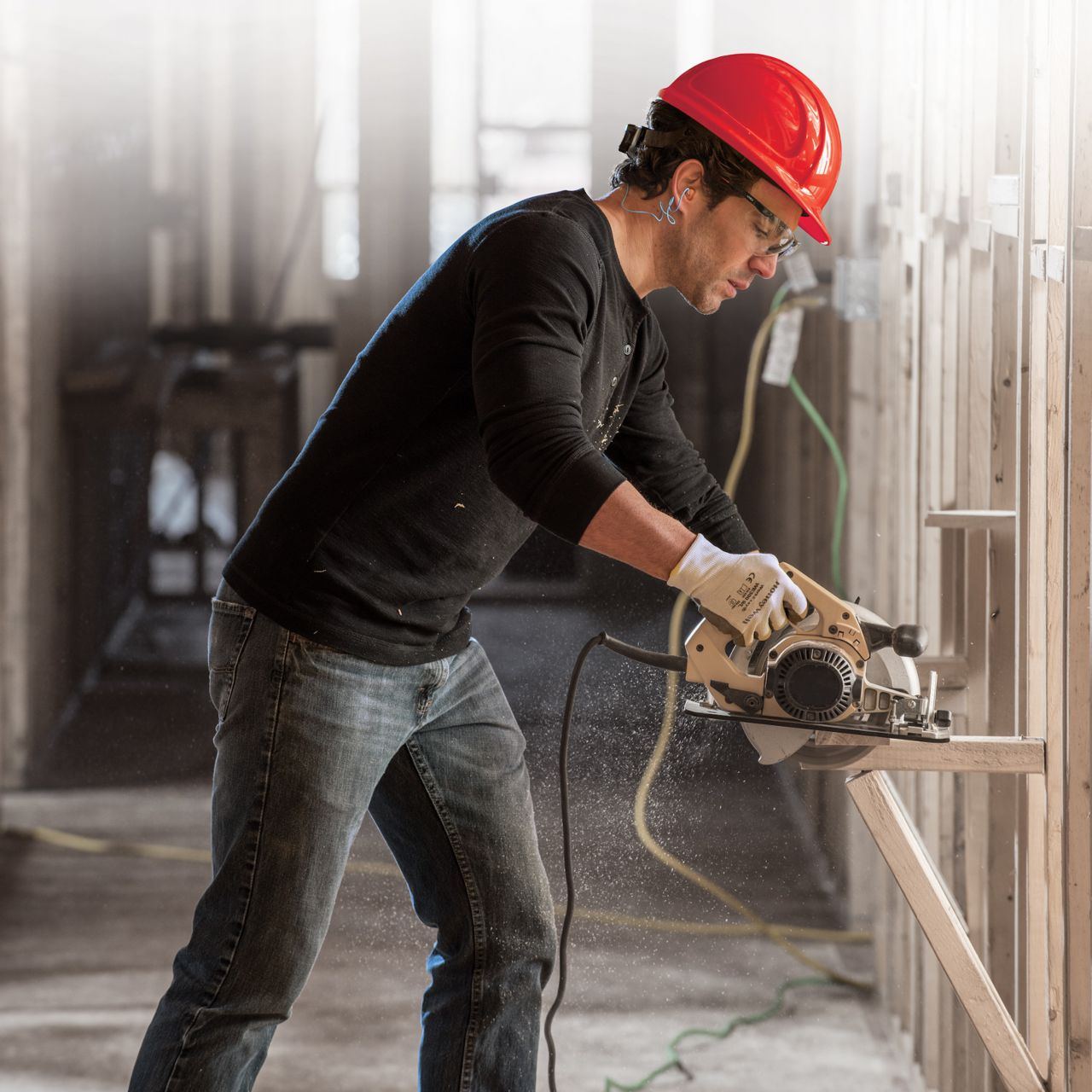 North_Zone_Hard_Hat_Worker_with_Saw