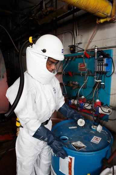 CF1000 on worker with hazardous drum