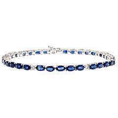 LIMITED QUANTITIES! 1/10 CT. T.W. Blue Sapphire 14K Gold Tennis Bracelet