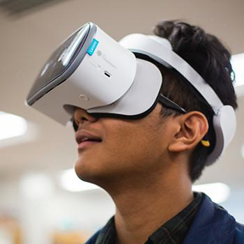 A student with a Lenovo Mirage Solo attending a VR classroom lesson