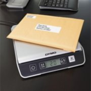 mail on top of a scale image number 2
