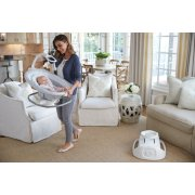sense 2 sooth 2 in 1 swing and rocker with baby inside carried by mother image number 4