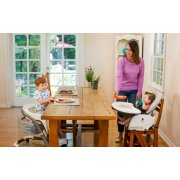 two children at table in blossom highchairs and booster seats image number 6