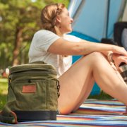 small soft cooler on picnic blanket next to woman image number 6
