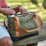 soft cooler outside on picnic table with pockets and faux leather handles image number 6