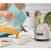 pouring soup from a blender jar image number 5