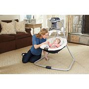 mother playing with baby inside simple sway baby swing image number 2