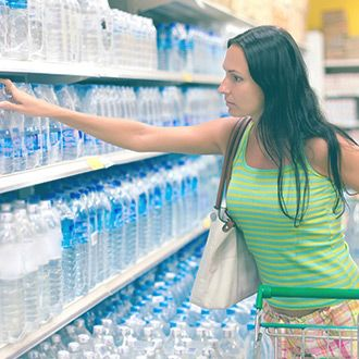 Woman shopping for bottled water