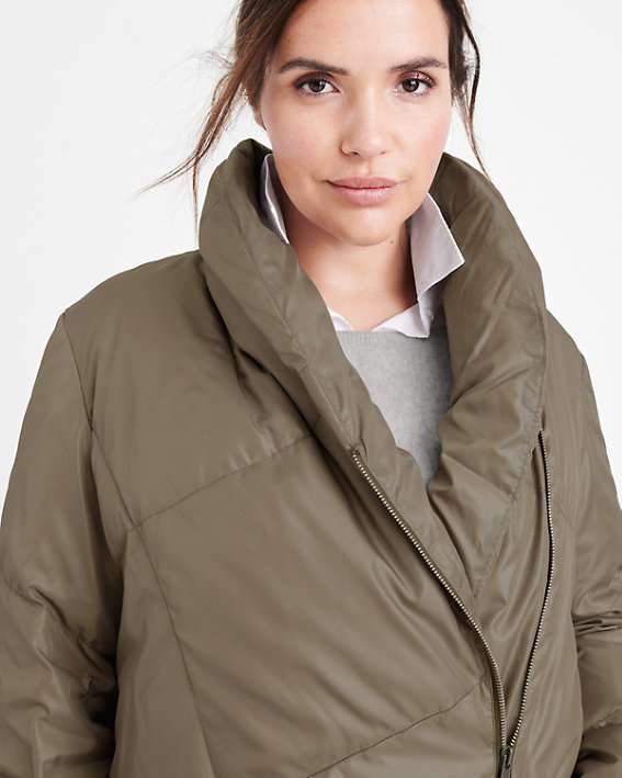 A brunette woman wearing a plus size puffer coat with a shawl collar