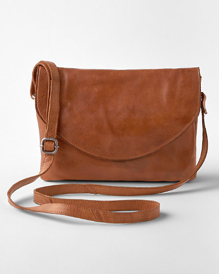 A tan leather Latico cross-body bag with a long strap