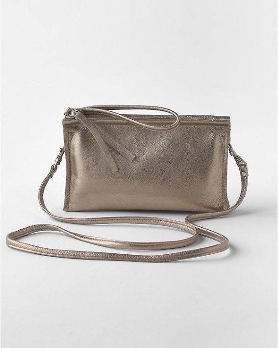 A shiny silver Rough and Tumble brand clutch purse with a long strap