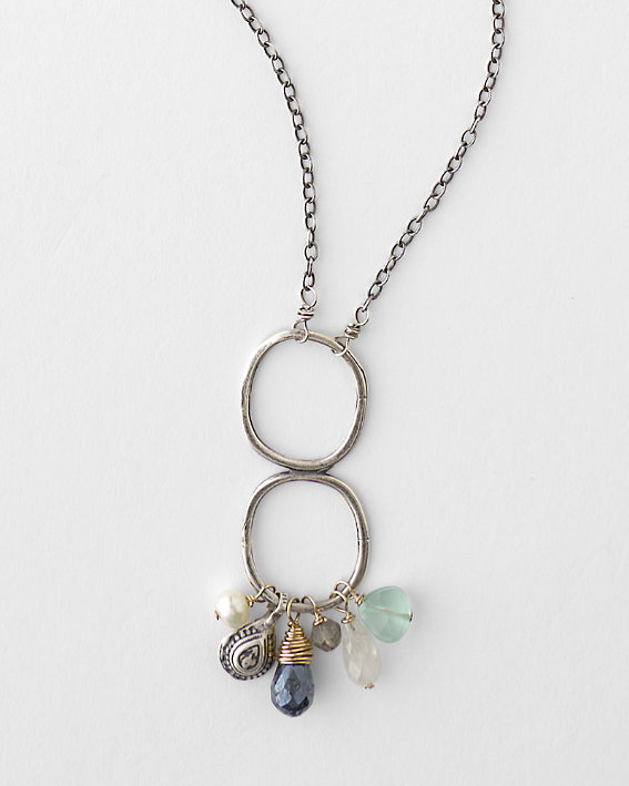 An elegant Original Hardware brand necklace made of silver colored metals with vintage charms