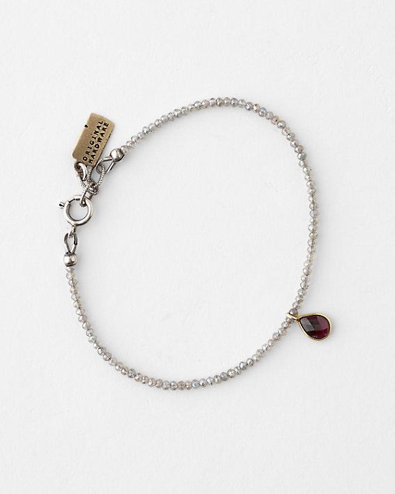 An elegant Original Hardware brand bracelet made of silver colored metals and gemstones