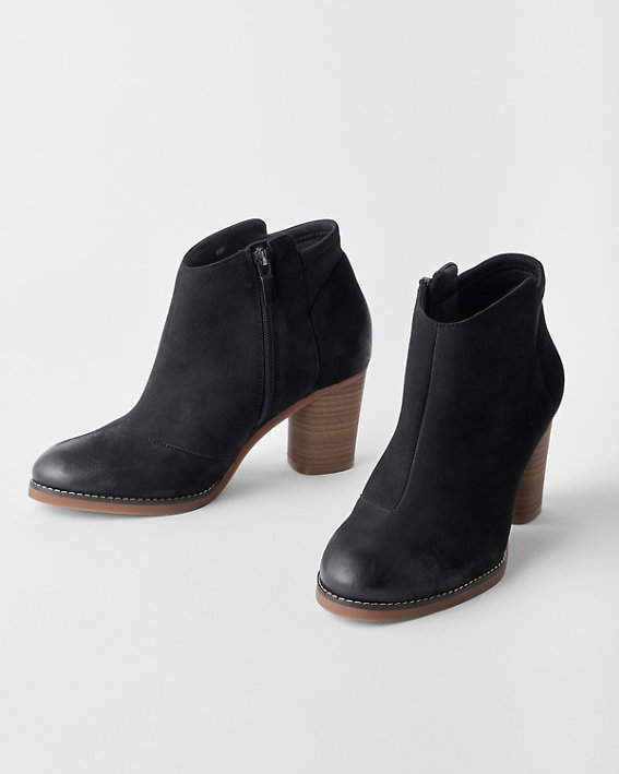 A pair of SoftWalk Kora black high heeled leather booties in wide width