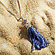 Tassel pendant on sand