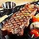 Strip steak on grill