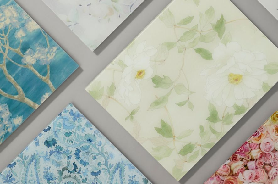 Assortment of large glass tiles inspired by art in a variety of colors and patterns.