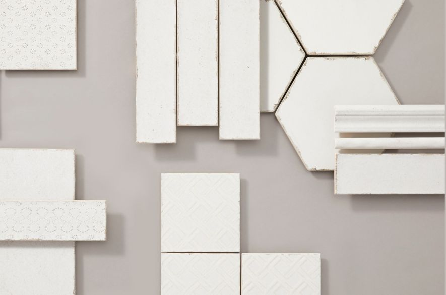 Assortment of fabric-inspired tile in a variety of shapes, sizes, and patterns.