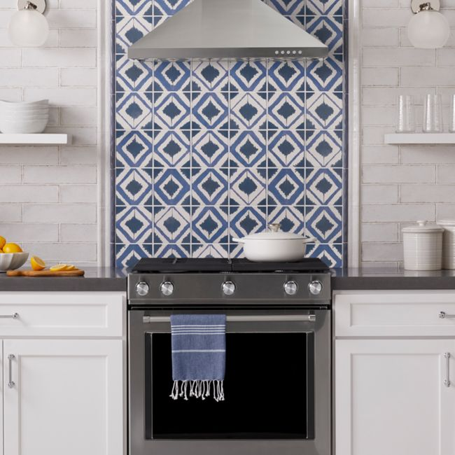 Blue and white kitchen with bohemian patterned tile.