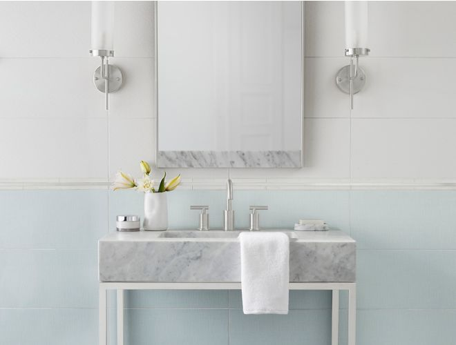 Lovely bathroom with subtly patterned blue and white tile.