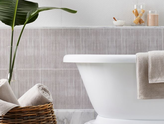 Bathroom with textured tile inspired by fabric.
