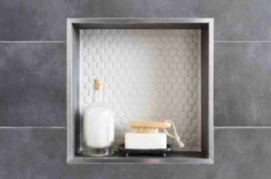 bathroom grey tiles and white hexagon tiles.