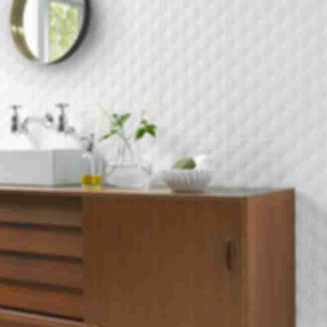Modern bathroom vanity with white textured designer wall tile.