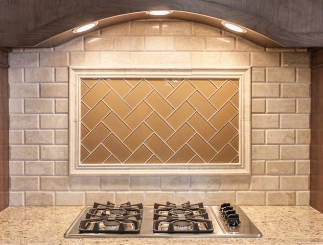 Beige subway tile on kitchen backsplash above stove.
