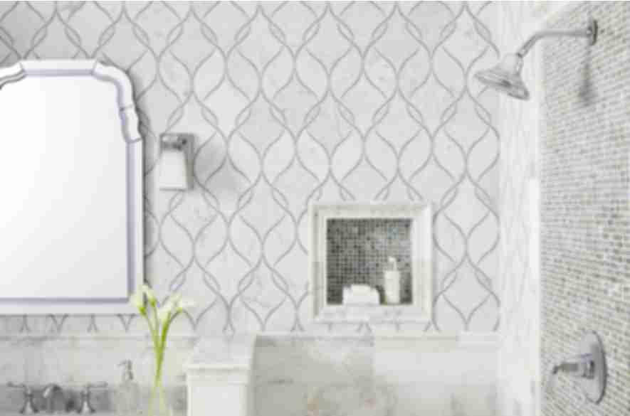 Stone mosaic shower with elegant pattern.