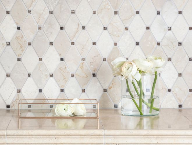 Brown and ivory marble diamond-shaped mosaic bathroom backsplash.