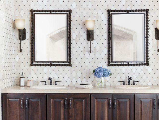 Traditional bathroom with cream and brown marble mosaic backsplash.