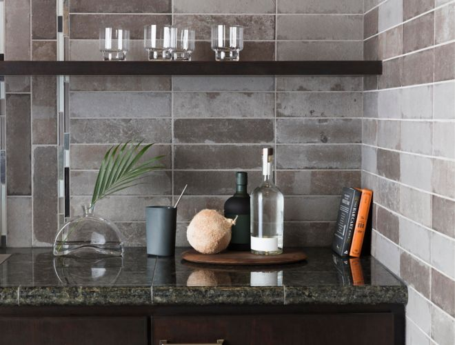 Kitchen backsplash with grey brick tile and stone and glass accent tile.