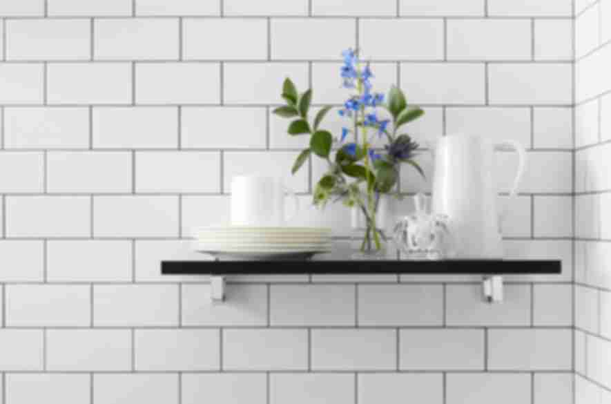 White subway tile with dark grout.