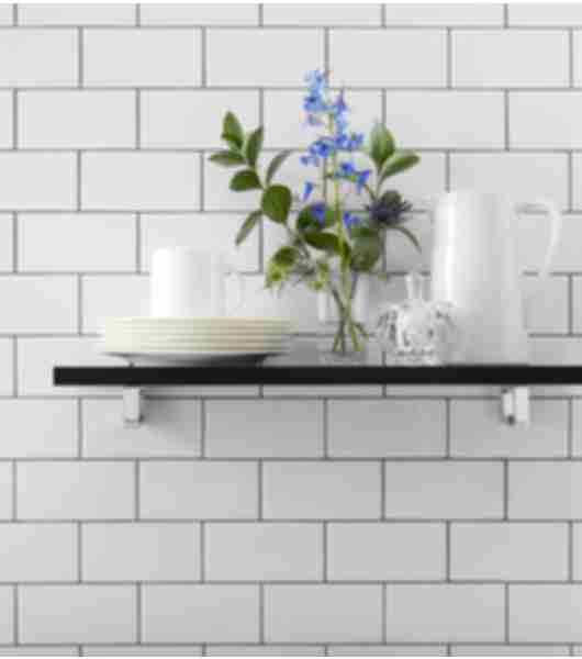 White subway tile kitchen wall floating shelves