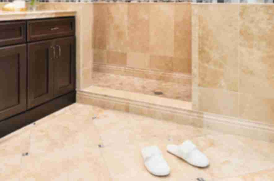 Bathroom with beige stone tile.