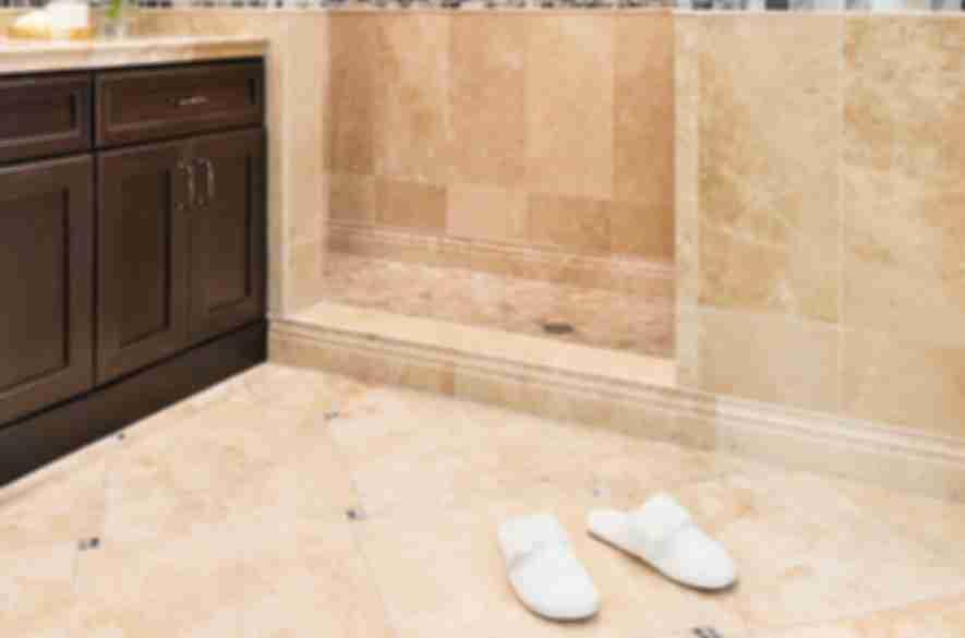 Bathroom with beige stone tile.