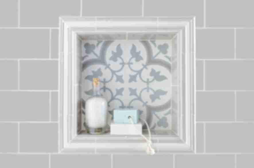 Bathroom insert with wall niche.