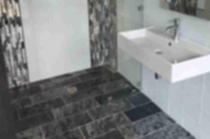 shades of dark grey bathroom tiles.